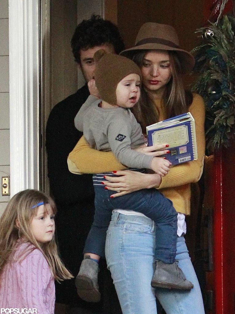 Orlando Bloom, Miranda Kerr, and Flynn Bloom attended a holiday party.