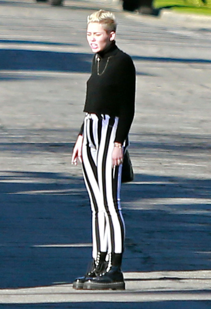 Miley Cyrus wore striped pants.