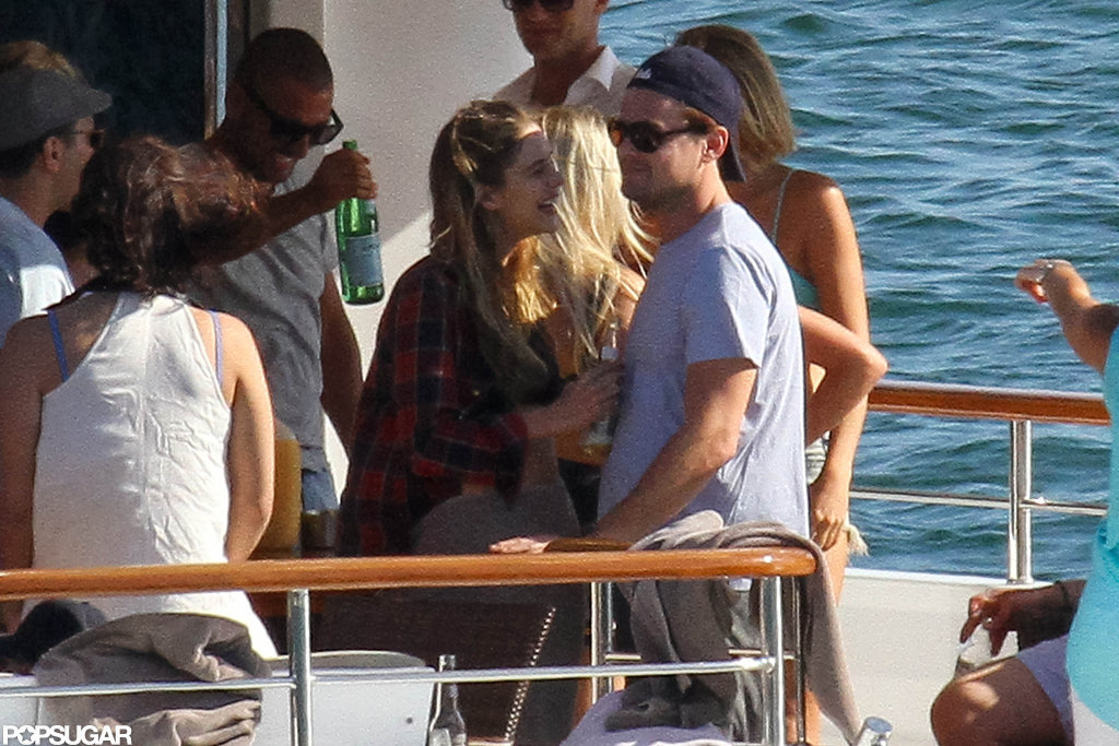 Leonardo DiCaprio chatted with a female partyer.