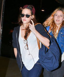 Kristen Stewart carried a duffel bag to the airport.