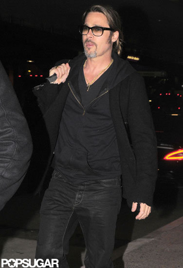 Brad Pitt carried his bag over his shoulder as he arrived at LAX.