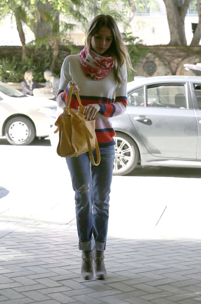 Jessica Alba's yellow Longchamp satchel made the perfect bright accessory against her boyfriend jeans and striped sweater.