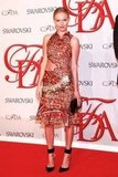 Only Kate could have pulled off the heavily embellished, printed cut-out Altuzarra dress that she wore to the CFDA Fashion Awards back in June 2012. She kept her accessories minimal, opting for a black clutch and pointy ankle-strap pumps.