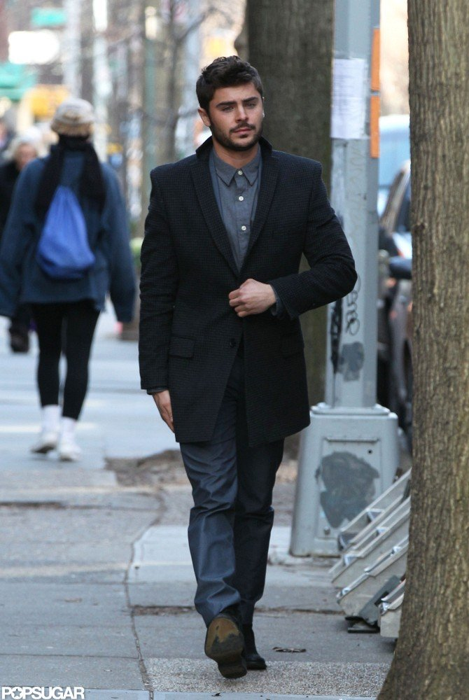 Zac Efron wore jeans and a long coat.
