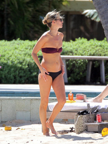 Kate Moss embraced the mismatched bikini look in a burgundy top and black bottoms on the sand in St. Barts.