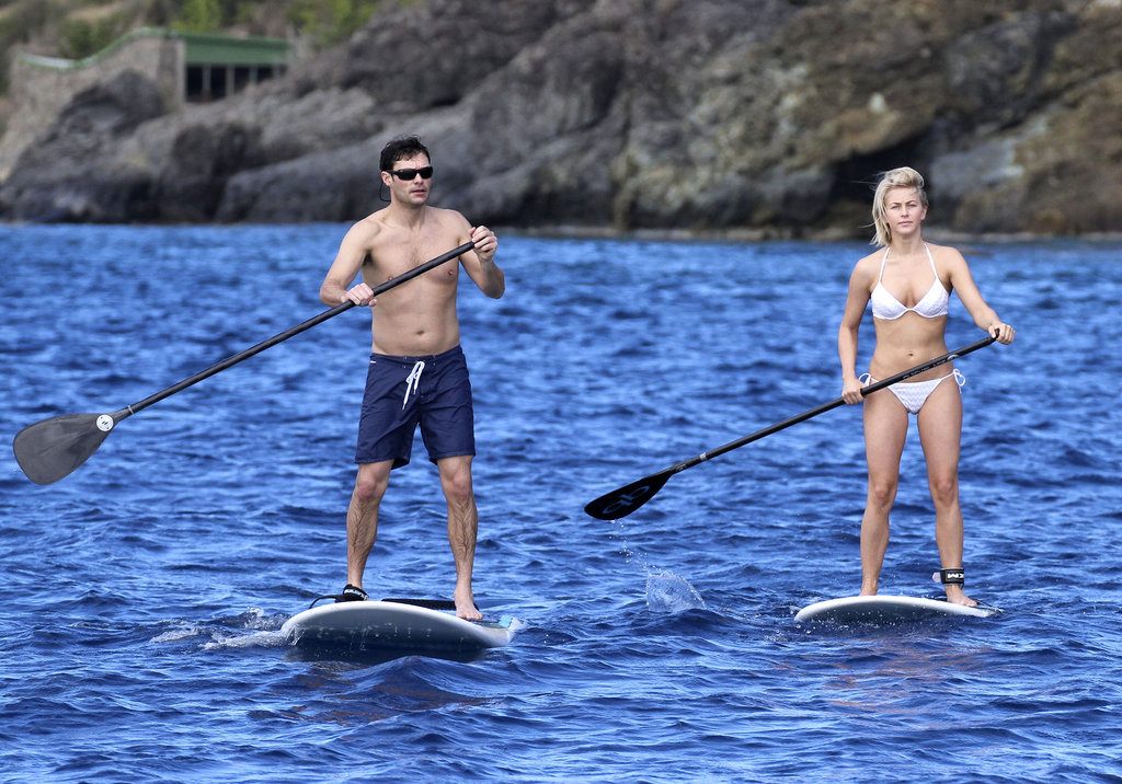 Bikini-clad Julianne Hough and shirtless Ryan Seacrest went for a paddleboard session in St. Barts together.
