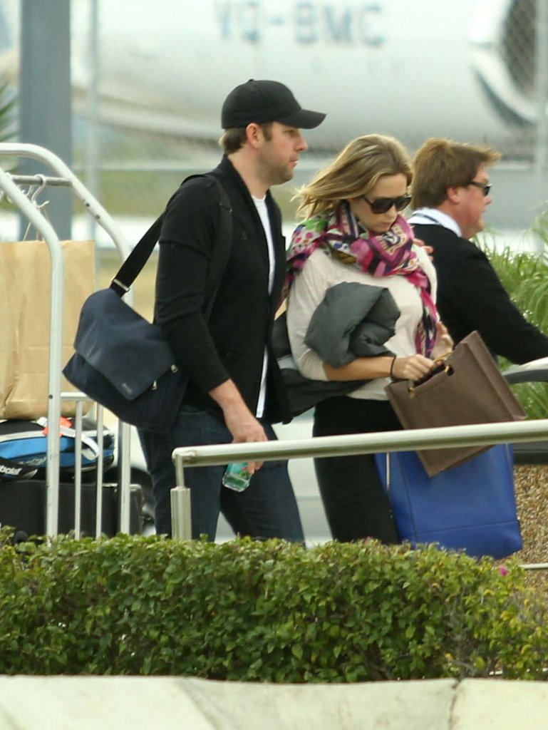 Emily Blunt and John Krasinski walked to their plane.
