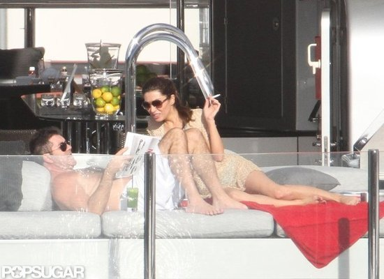 Simon Cowell and Mezhgan Hussainy lounged on a yacht.
