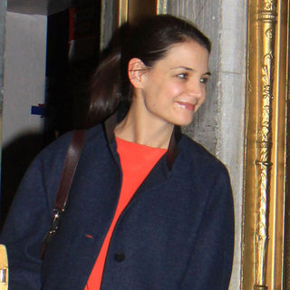 Katie Holmes in a Balenciaga Coat Leaving Dead Accounts