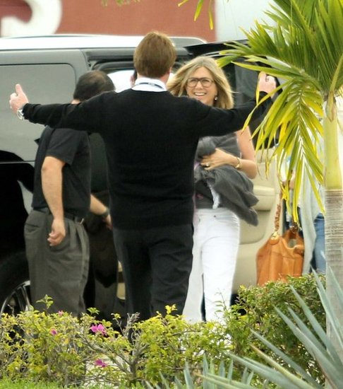 Jennifer Aniston hugged a friend as she left Cabo.