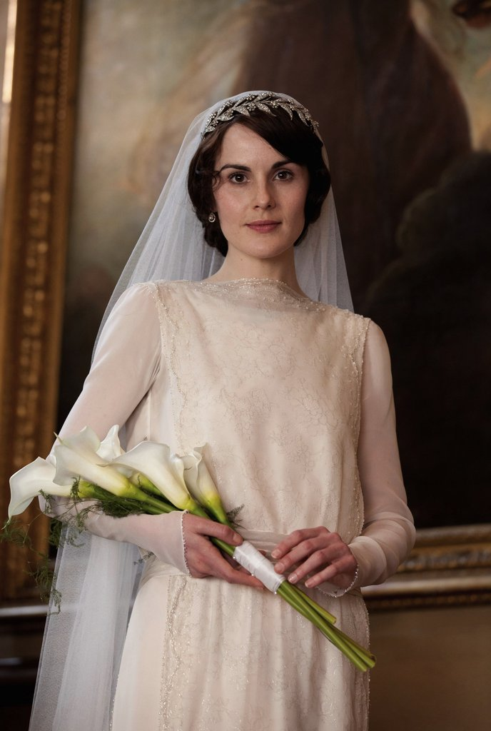 Mary has the bridal look down. Her vintage veil is held in place with a 45-carat floral diamond tiara (valued at $200,000). Source: PBS