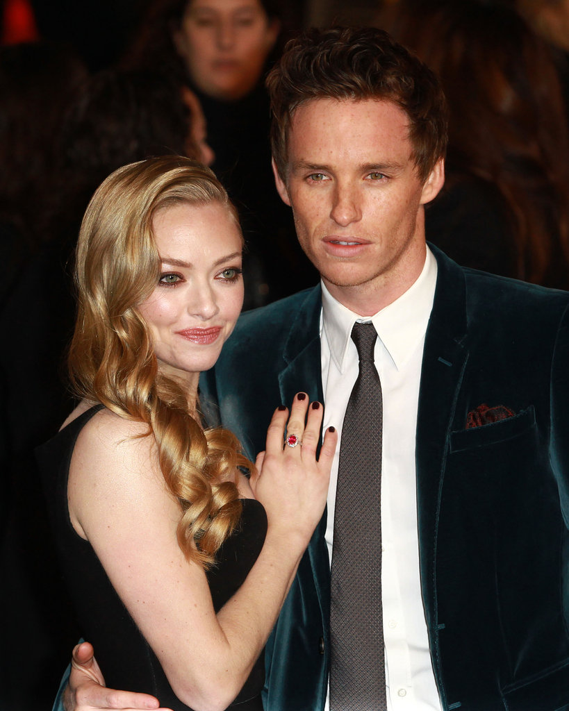 Eddie had his Les Misérables costar Amanda Seyfried close by at the film's world premiere in December.