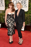 Tina Fey and Amy Poehler pose together on the red carpet.