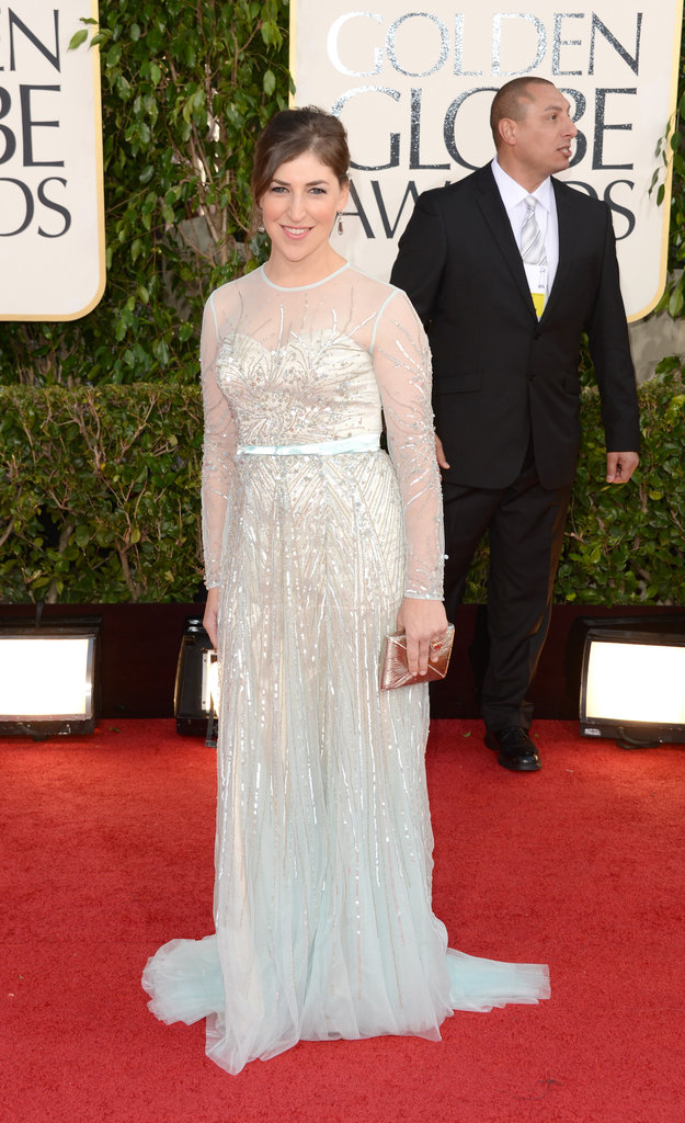 Mayim Bialik — mom to Miles, 7, and Frederick, 4 — covered up in white and silver on the red carpet at the Golden Globes.