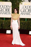 Downtown Abbey star Michelle Dockery posed in a gold embellished dress.
