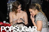 Amy Adams shared something on her phone with Kristen Bell.