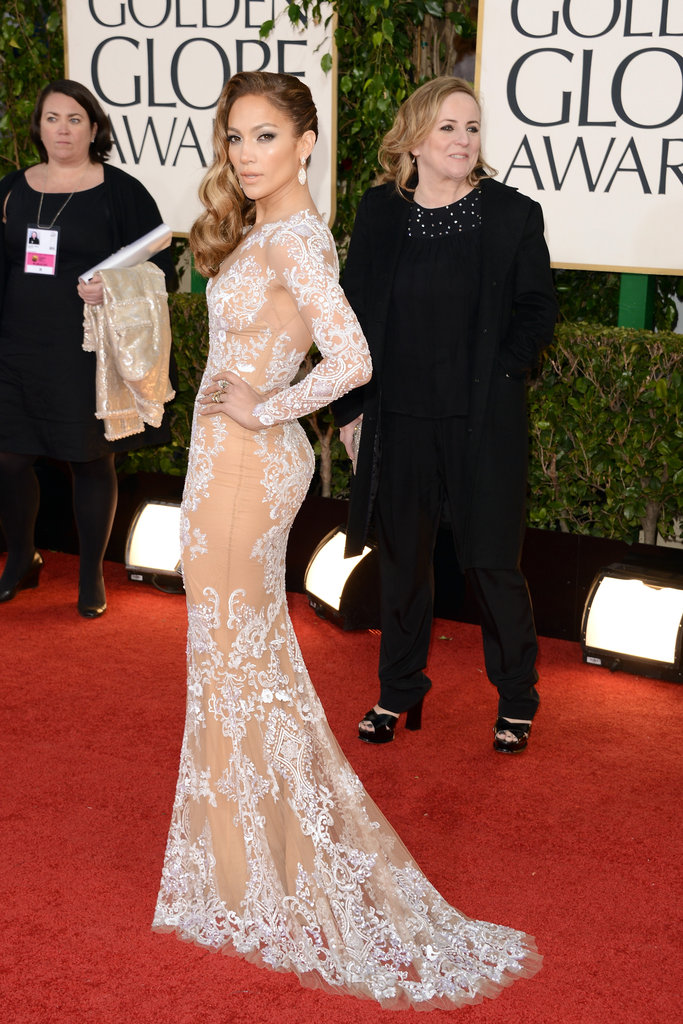 Jennifer Lopez showed skin in her lacy Zuhair Murad gown.
