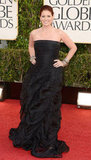 Debra Messing arrived in a black Donna Karan ballgown.