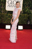 Sienna Miller looked back for the cameras as she showed off her floral Erdem dress on the carpet.