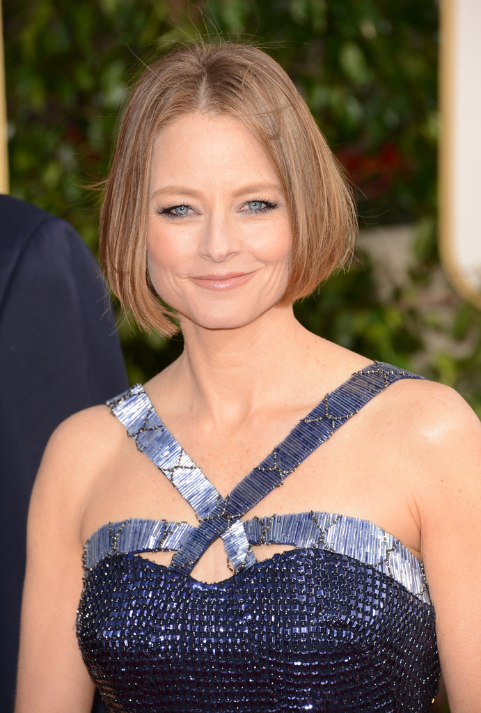 Mom of two Jodi Foster shone in a metallic blue dress at the Golden Globes.