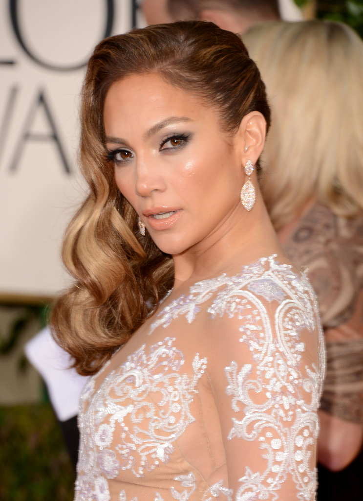 Jennifer Lopez arrived at the Golden Globes in a detailed nude dress.