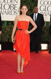 Marion Cotillard arrived on the carpet in bright Christian Dior and a leopard clutch.