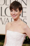 Big winner Anne Hathaway was a vision in white Chanel Sunday night.