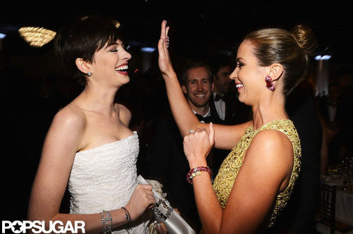 Anne Hathaway and Emily Blunt shared a laugh inside the Globes.