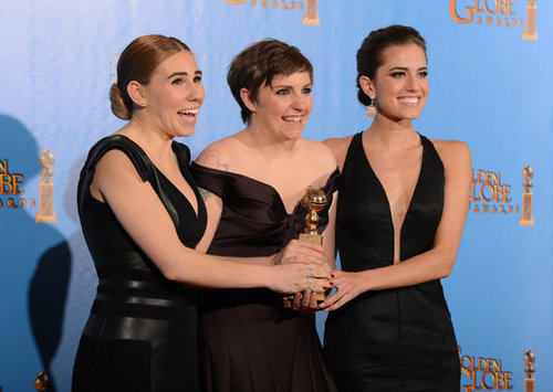 The girls of Girls posed with their Golden Globe in the press room.