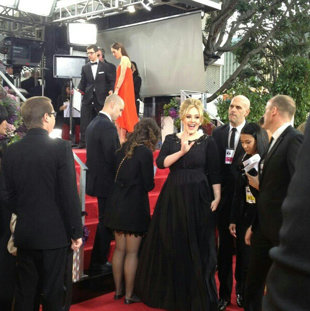 Adele Waves to Everyone