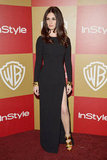 Paz Vega donned a long-sleeved black gown, but kept things interesting with a sexy leg slit and metallic heels.