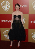 Emma Roberts struck a sexy, lingerie-inspired note in this black corseted dress. And what boudoir cocktail dress doesn't deserve its red-pump complement? This look was red-hot.