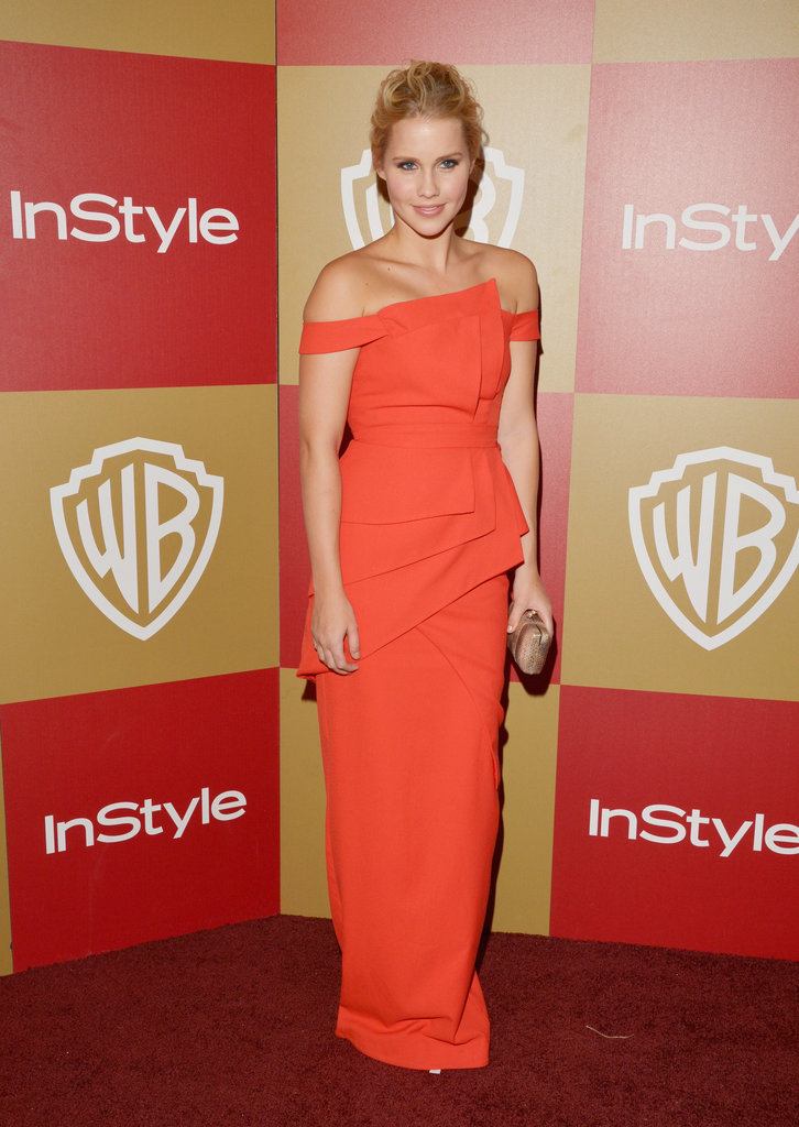 The Vampire Diaries star Claire Holt chose an edgier red dress for her appearance at the InStyle party.