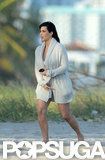Pregnant Kim Kardashian Shows Her Bikini Bottoms at a Beach Shoot