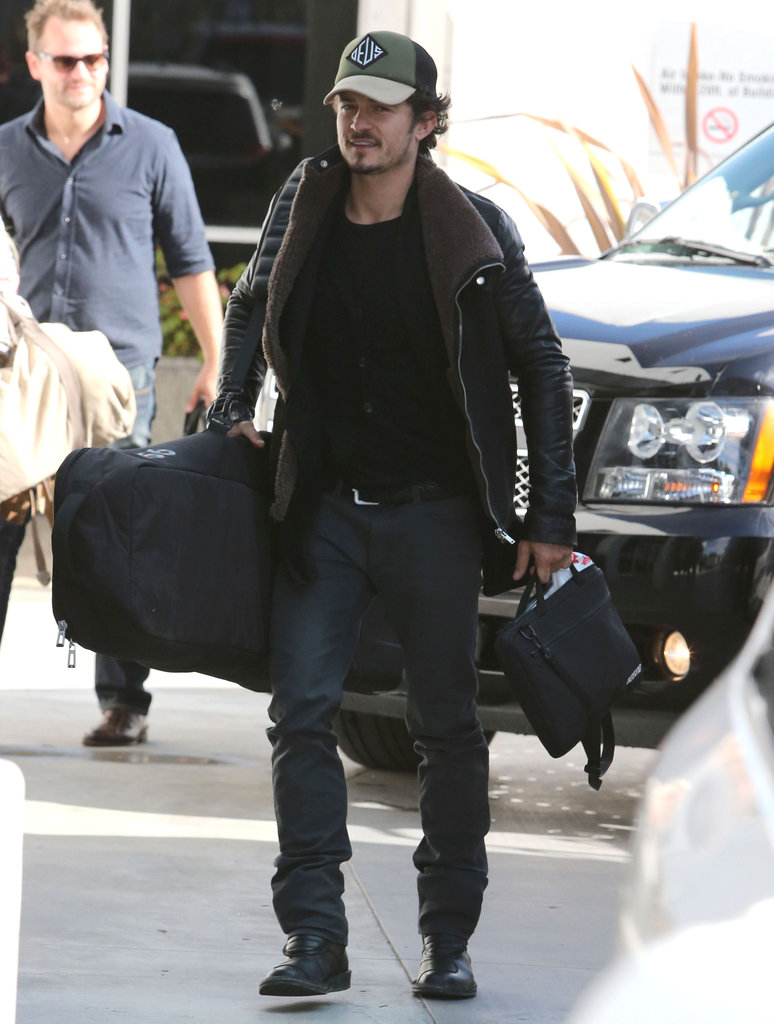 Orlando Bloom departed on a plane out of LAX.