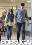 Lea Michele held hands with boyfriend Cory Monteith as they arrived at LAX together.