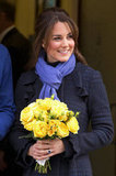 A pregnant Kate Middleton left the King Edward V11 Hospital with a bouquet of yellow flowers in December 2012.