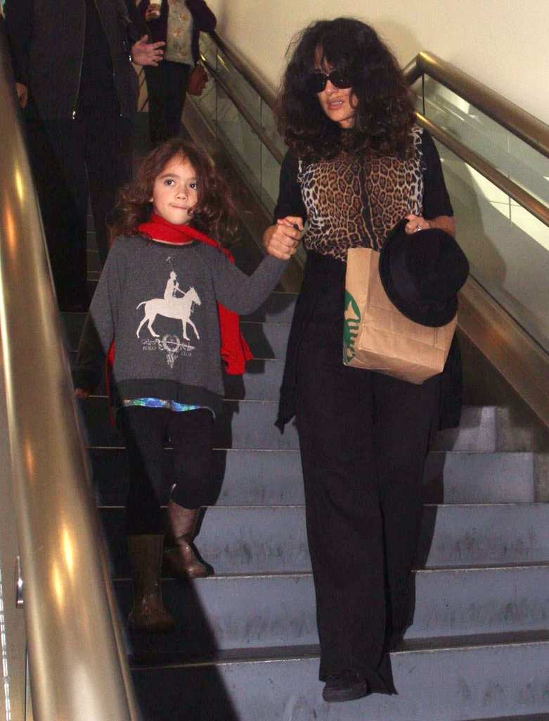 Salma Hayek guided her daughter down the stairs.