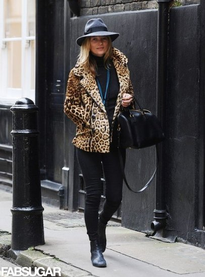 Kate Moss strutted her stuff in a leopard peacoat and wool hat.