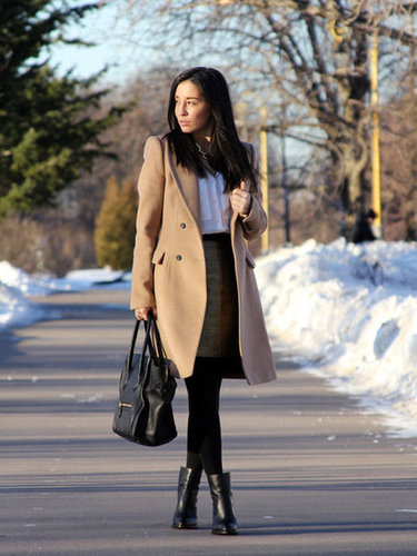 The classics, redefined — a camel coat to top tights and booties, with a Celine tote in tow. Source: Lookbook.nu