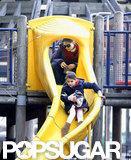 Katie Holmes watched Suri go down a slide.