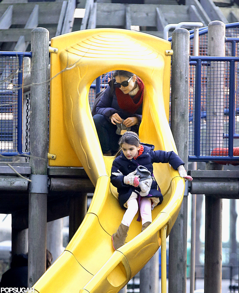 Katie Holmes watched Suri go down a slide.