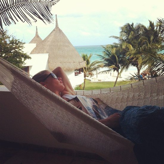 Doutzen Kroes lounged in a hammock with a copy of Vogue. Source: Twitter user Doutzen