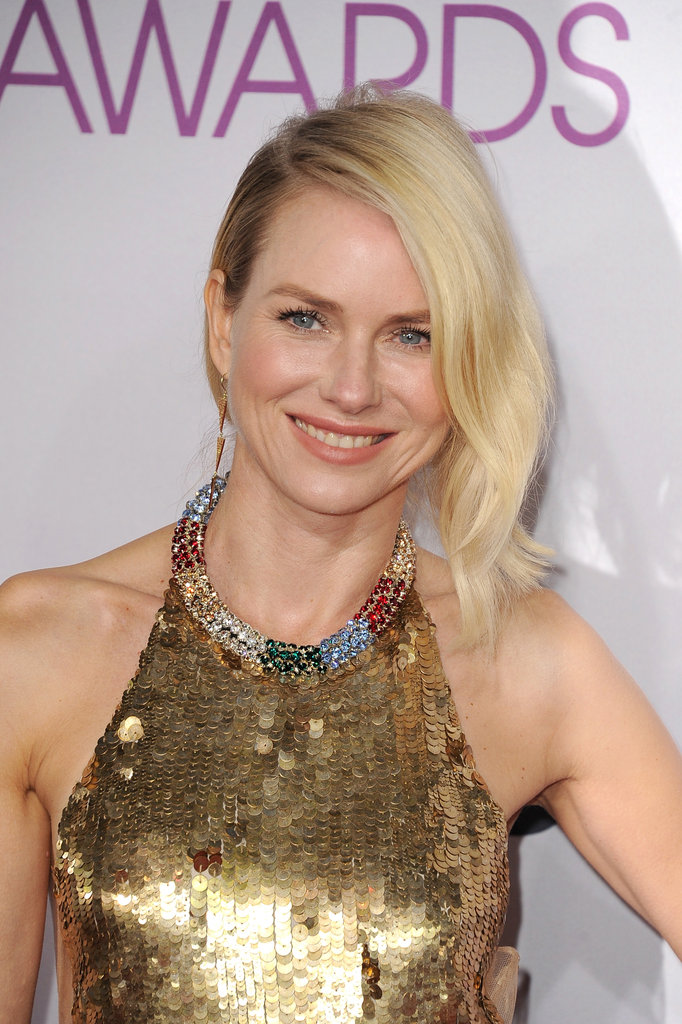 Naomi Watts was glowing in gold.