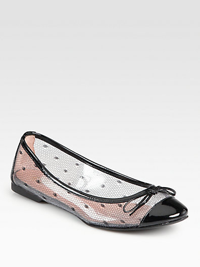 We love the slightly futuristic feel of these Red Valentino Polka-Dot Mesh Ballet Flats ($295).