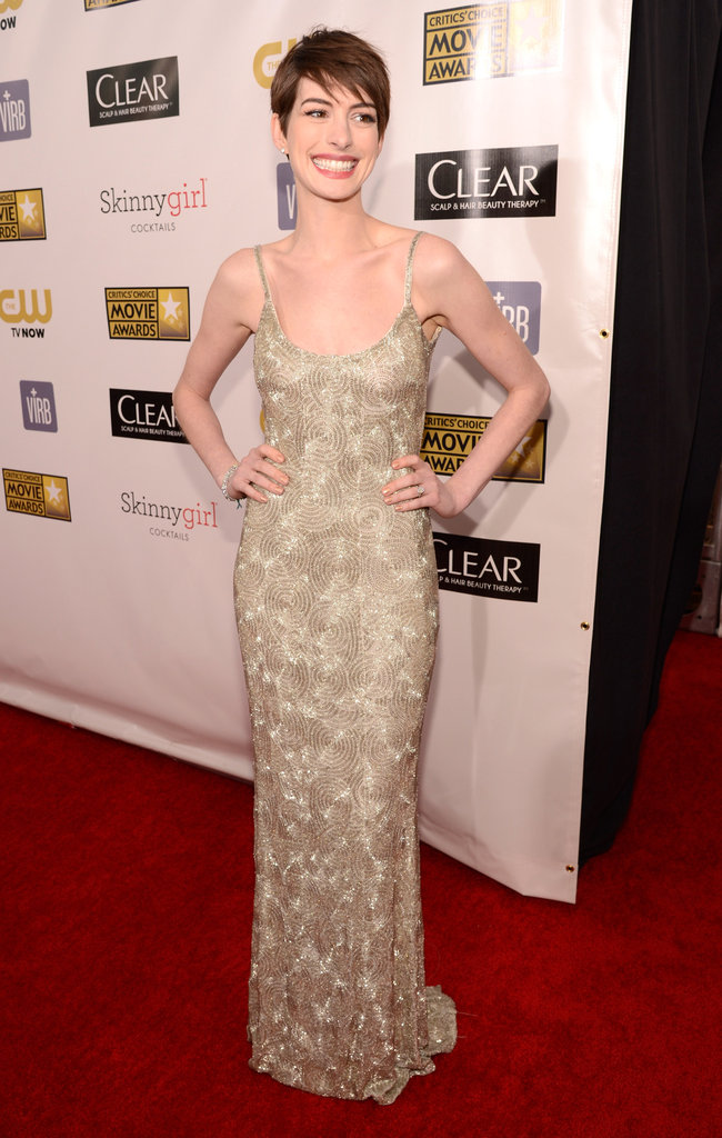 Anne Hathaway wore a gold gown.