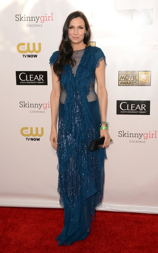 Famke Janssen wore a sheer blue gown.
