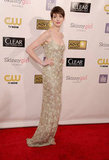 Anne Hathaway posed in a metallic Oscar de la Renta gown.