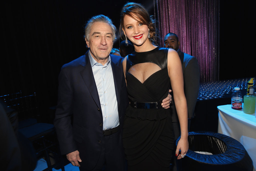 Silver Linings Playbook co-stars Robert De Niro and Jennifer Lawrence posed backstage after the movie won best comedy.