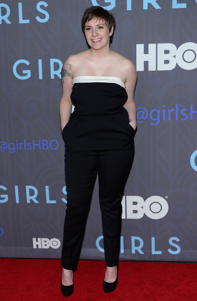 Lena Dunham stepped out in a strapless black — with just a hint of white at the neckline — Valentino jumpsuit for the season two premiere.